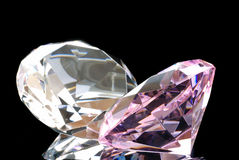 Gems on Black. Horizontal Image of a Colored and a Clear Diamond Cut Gems Against a Black Background Royalty Free Stock Image