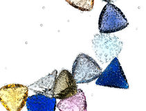 Gems falling in pure water. Stock Photos
