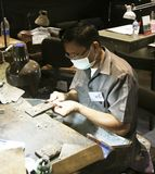 PHUKET, THAILAND - JUNE 29, 2018: A jeweler at work. Gems Gallery on Phuket Island, Thailand. Gems Gallery is one of the biggest jewelry stores in the world Stock Photos