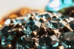 Gems macro. Blue gem macro and gold Stock Photos