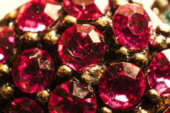 Gems macro. Red Gems macro and gold Royalty Free Stock Photo