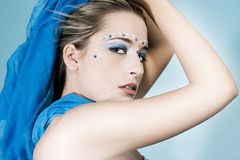 Gems and makeup. Attractive young model with gems and makeup Stock Photos