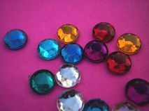 Gems on pink royalty free stock photos