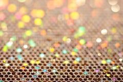 Gems in the Rough. Macro photo of aqua, blue, green, orange, pink glitter Royalty Free Stock Photography
