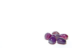 Gems stone. At a corner with space for photo or text Royalty Free Stock Photos