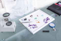 Gems and tools on the table gemologist.