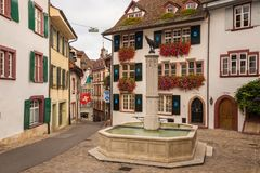 Gemsberg fountain and colorful buildings in Basel Stock Image