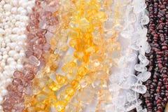 Gemstone beads. Close up of the citrine, quartz, topaz and garnet gems Stock Photos