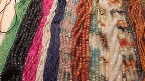 Gemstone beads. Of different colors for sale stock video