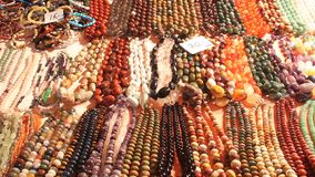 Gemstone beads. Of different colors for sale stock footage