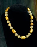 Gemstone beads and gold necklace Stock Photography