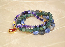 Gemstone bracelets - amethyst lapis lazuli and agate Stock Photo