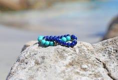 Gemstone bracelets on the beach advertisement Stock Photo