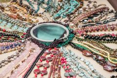 Gemstone bracelets and necklaces made of malachite, rose quartz, larimar, mahogany obsidian, unakite, amethyst, chalcedony, green stock photo