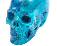Gemstone chrysocolla carved realistic crystal skull from Peru. Isolated on white background Royalty Free Stock Images