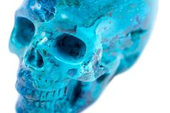 Gemstone chrysocolla carved realistic crystal skull from Peru. Isolated on white background Royalty Free Stock Photography