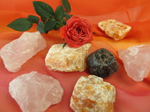 Gemstone mix for water revitalization love and harmony. And rose flower Royalty Free Stock Photography