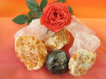 Gemstone mix for water revitalization love and harmony. And rose flower Royalty Free Stock Photo