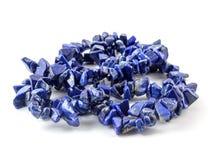 Gemstone natural lapis lazuli on white background, beads
