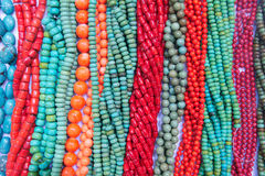 Gemstone necklaces. The background of colored gemstone necklaces Stock Photo