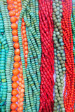 Gemstone necklaces. The background of colored gemstone necklaces Royalty Free Stock Photos