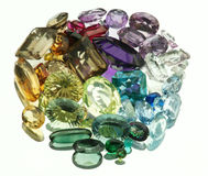 Gemstones. Large variety of real Gemstones on mirror, Studio shot Royalty Free Stock Image