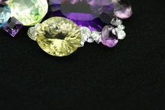 Gemstones. Mixed gemstones on black velvet background Stock Photo