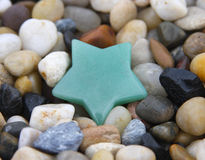 Gemstones. A green aventurine crystal gemstone carved in the shape of a star and polished for use in natural healing practice and alternative energy medicine Royalty Free Stock Photo
