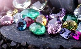Gemstones collection jewelry set photo with black stone and dark lighting stock photo