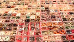 Gemstones jewelery. Gemstones of different colors and shape for sale stock video footage