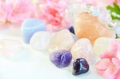 Gemstones with pink flower Stock Photo