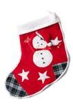 Genähter Schneemann auf einer roten Weihnachtssocke. Stockfotos