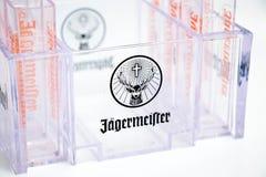 Genève/Schweiz - mars 20, 2018: hjortar för logo för märke för jagermeisterstarkspritskott glass Fotografering för Bildbyråer