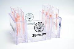Genève/Schweiz - mars 20, 2018: hjortar för logo för märke för jagermeisterstarkspritskott glass Arkivbild