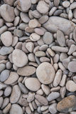 Genauere Draufsicht des Naturhintergrundes des grauen und braunen Strandes entsteint Hintergrund Lizenzfreies Stockbild