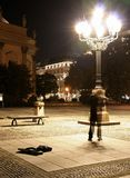 Gendarme. Violinist busking at midnight, berlin, germany Stock Photo