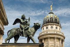 Gendarmenmarkt. Statue at the Entrance of the Konzerthaus and Dome of the French Cathedral, in Berlin Royalty Free Stock Photos