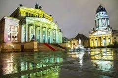 Gendarmenmarkt square illuminated during sunset in Berlin city center, Germany Stock Images