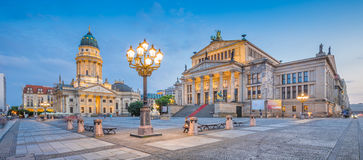 Gendarmenmarkt square panorama at dusk, Berlin, Germany. Panoramic view of famous Gendarmenmarkt square with Berlin Concert Hall and German Cathedral in twilight Stock Images