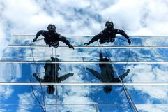 Gendarmes climbing down building Royalty Free Stock Images