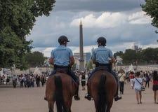 Gendarmes on horseback in Paris Stock Photography