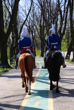Gendarmes riding Stock Photos
