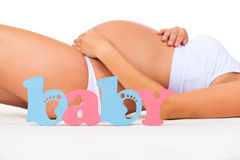 Gender of child: boy, girl or twins? Concept of pregnancy. Pregnant woman.  stock image