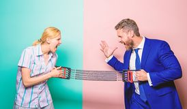 Gender equality and discrimination. Gender rivalry concept. Man and woman stretching expander opposite sides. Business stock image