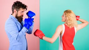 Gender equality. Man formal suit and athletic woman boxing fight. Couple in love competing in boxing. Female and male royalty free stock photography