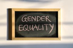 Gender Equality, words written with chalk on board. Gender Equality, word hand written with chalk on board stock photo