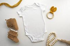 Gender Neutral Blank White Baby Bodysuit Flat lay Mockup