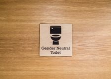 Gender neutral toilet sign on door royalty free stock photos