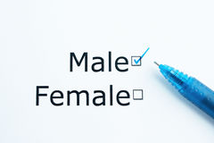 Gender question. A market research question about gender with a blue pen stock image