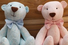 Gender Reveal Party! Boy or Girl? Cute handmade pink and blue bears on a wooden background stock photo